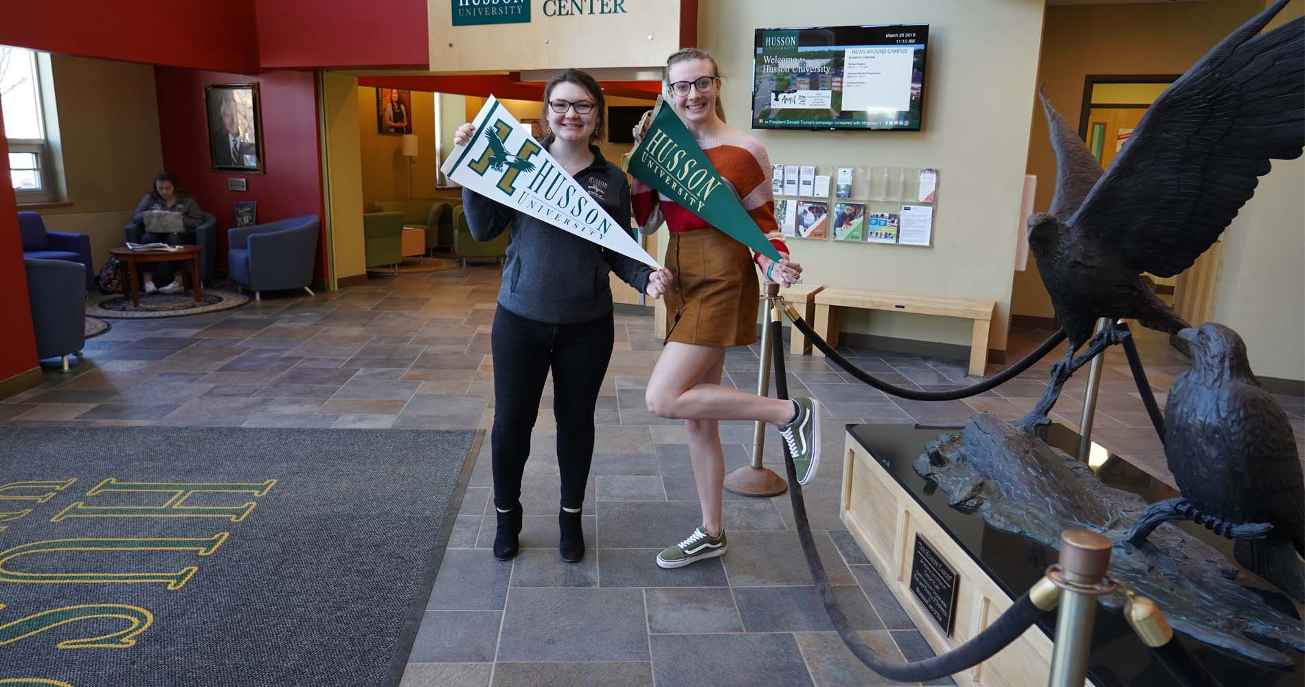 Husson University Eagle Ambassadors in the Welcome Center