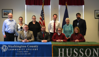 members of Husson and WCCC at signing ceremony