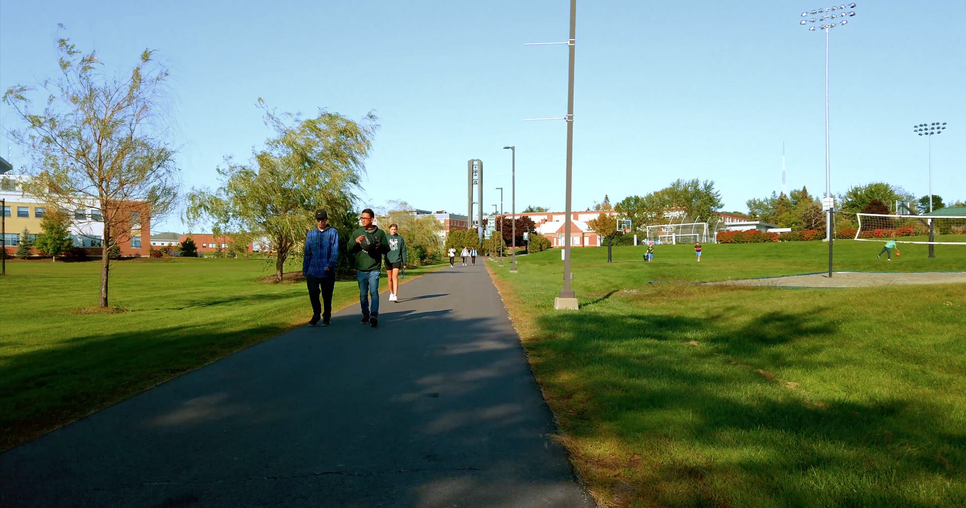 Students walk on campus at Husson University