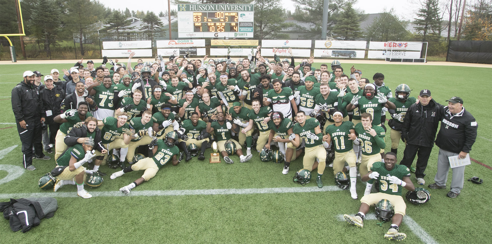 Football poses at the Dr. John W. Winkin Complex after a win against Gallaudet