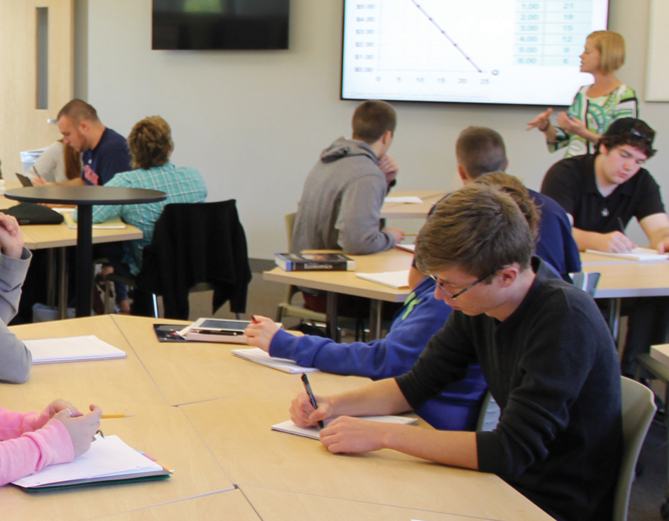 students work in a classroom in the school of business and management