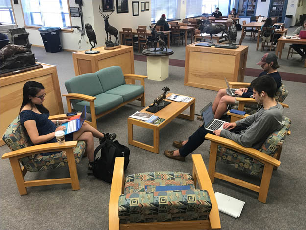 Students enjoying the Husson Library
