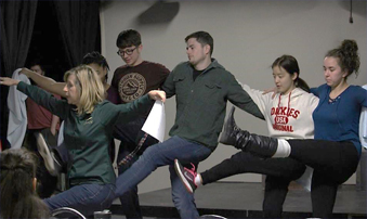 Cast and crew rehearsing for You're a Good Man Charlie Brown