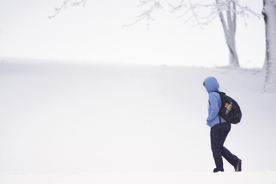 Student walking in snow