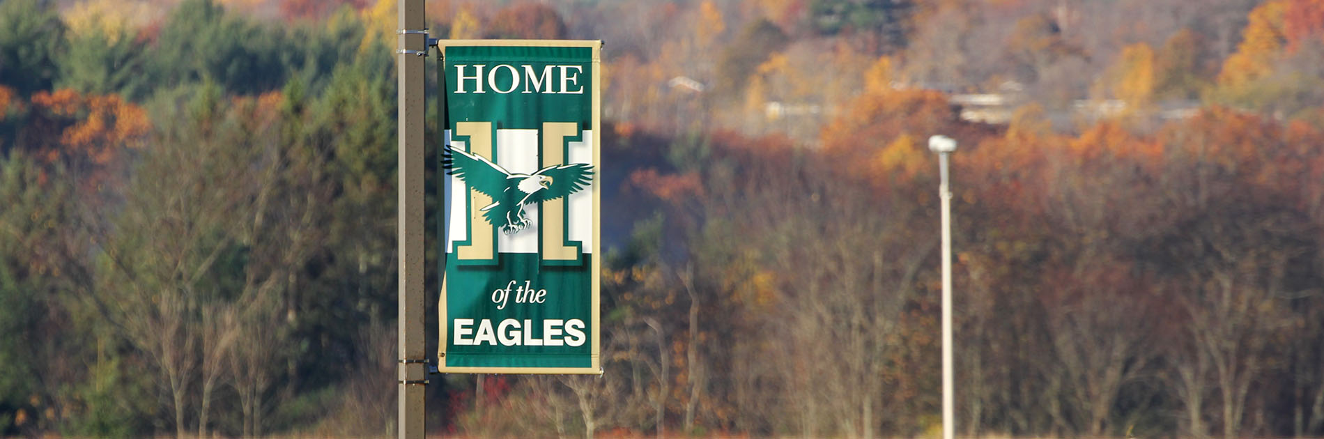 Eagle banner on the campus of Husson University