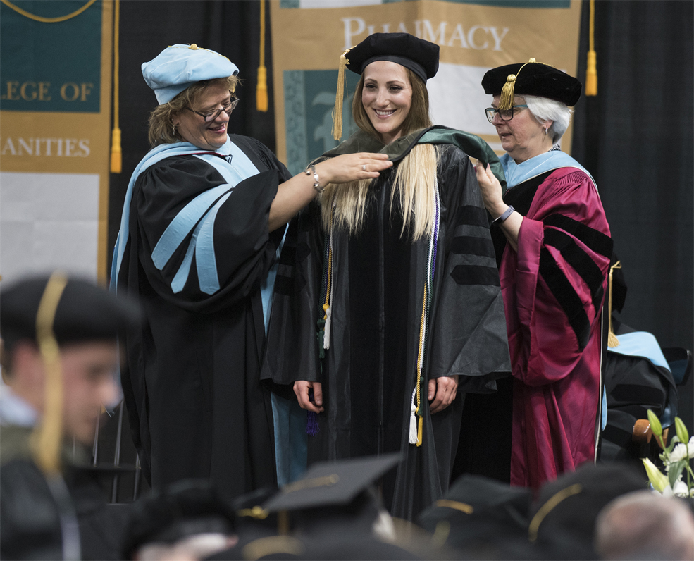 Graduate students being hooded during commencement exercises