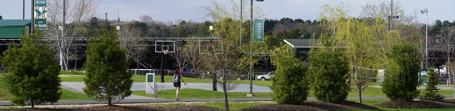 students walking on campus of Husson University