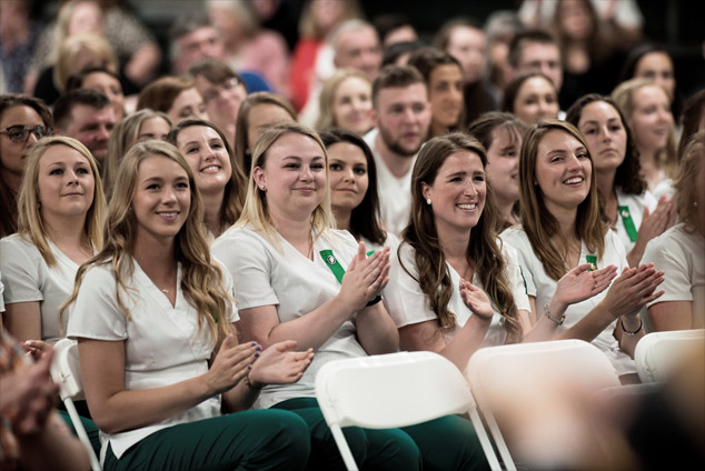 New graduates attend the nurses pinning ceremony