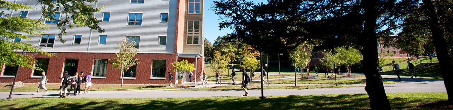 Student walking in front of the Darling Living Learning Center
